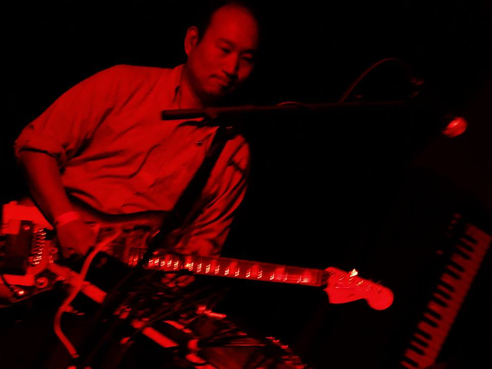 Ernie plays guitar with a number of musical acts.  Shown here playing with the band Crash Safely.