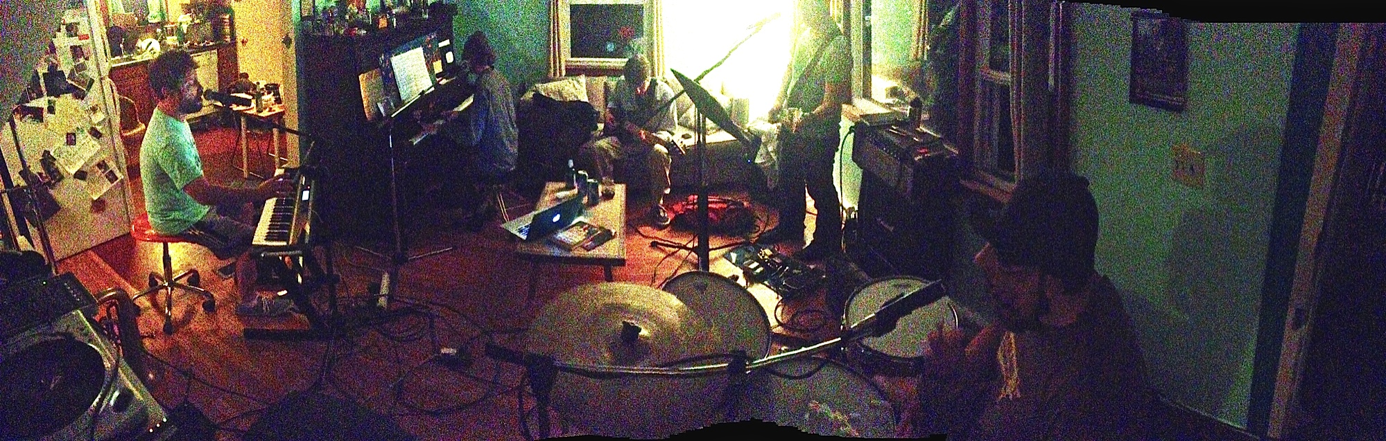 Pragnus Gray Collective prepares for the CD release performance at Adam's house.